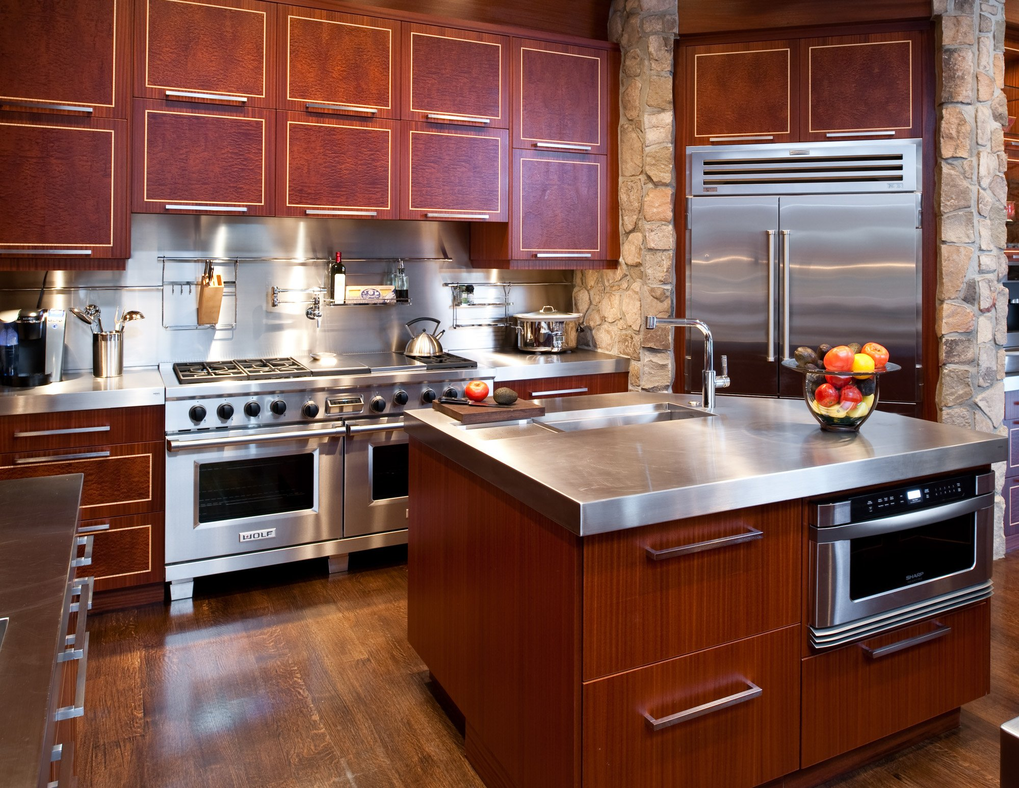 Manganaro, T&G- 2009- Kitchen- Neff Mahogany w Inlay- Contemporary- Stainless steel countertop and backsplash, microwave drawer, trough sink, backsplash rack- The Downs